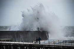© Licensed to London News Pictures. Aberystwyth UK  03/03/2019. Storm Freya, the latest named storm to hit the UK, strikes with her full force against the harbour defences in  Aberystwyth on Sunday evening. The Met Office has issued a yellow warning for much of the western parts of the UK, with gusts of  wind between 70 and 80mph forecast for exposed Irish Sea coasts overnight tonight, with the risk of damage to property and severe injuries to people from flying debris. Photo credit: Keith Morris / LNP