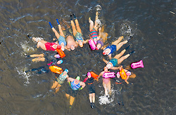 Callander, Scotland, UK. 12th Jan 2020. Drone images of open water swimmers from the Fife Wild Swimmers club take advantage of the cold but sunny weather to go swimming in Loch Lubnaig in The Trossachs, Stirlingshire. Apart from their usual swim they took time to have fun and practice some synchronised swimming moves before the cold forced them from the loch.  Iain Masterton/Alamy Live News