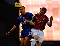 Photo: Daniel Hambury.<br />West Ham United v Manchester United. The Barclays Premiership. 27/11/2005.<br />West Ham's Teddy Sheringham and Manchester's Mikael Silvestre battle for the ball.