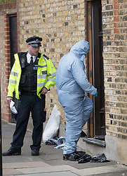 © Licensed to London News Pictures. 21/09/2017. London, UK. A police forensics officer enters a house where police and the fire brigade attended and found a burnt body in the garden. A 40-year-old man and a 34-year-old woman were arrested at the scene on Wednesday, 20 September on suspicion of murder. Photo credit: Peter Macdiarmid/LNP
