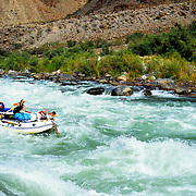 Adventurers shoot the rapids of Lava Falls in the Colorado River at the bottom of the Grand Canyon, Grand Canyon National Park, Arizona.