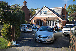 © Licensed to London News Pictures. 03/10/2016. Crowthorne, UK. A police car sits in the drive of a house where police found a women in her 50's, who was dead, and an injured man. It is thought that the incident is being treated by the Thames Valley Police as one case of murder and one of attempted suicide.  Photo credit: Peter Macdiarmid/LNP
