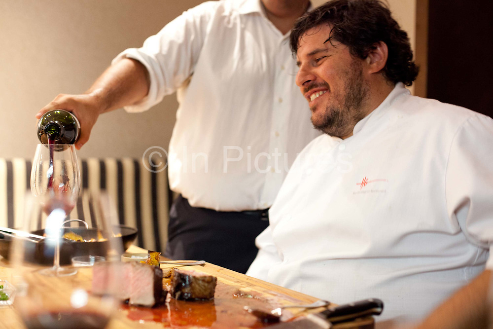 Chef drinking wine after a long night cooking, One Table with Hernán Gipponi at the HG restaurant in the Fierro Hotel in Palermo, Buenos Aires, Federal District, Argentina.