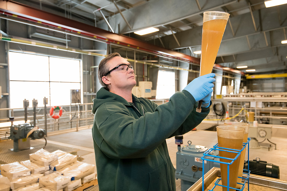 Man testing water quality in a water purification plant