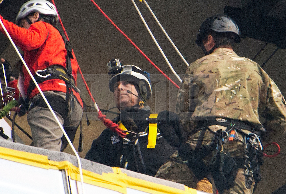 © London News Pictures. 03/09/2012. London, UK.  Prince Andrew talking to experts at a midpoint of his descent.  Prince Andrew, The Duke of York abseiling down The Shard building in Central London on September 3, 2012. The Prince joined Ffion Hague billionaire John Caudwell and a team of 37 others to take part in a charity abseil down London's tallest building to raises funds for The Outward Bound Trust and the Royal Marines Charitable Trust Fund. Photo credit: Ben Cawthra/LNP