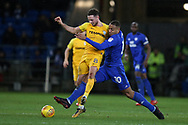 Alan Browne of Preston North End (l) is tackled by Kenneth Zohore of Cardiff city. EFL Skybet championship match, Cardiff city v Preston North End at the Cardiff city stadium in Cardiff, South Wales on Friday 29th December 2017.<br /> pic by Andrew Orchard, Andrew Orchard sports photography.