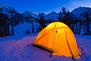 Yellow dome tent in winter, John Muir Wilderness, Sierra Nevada Mountains, California USA