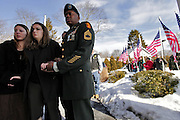 Elizabeth Harrington, sister, and Faith Harrington, wife, wait for the body of Sgt. Kyle J. Harrington to be brought into the funeral home.  Family members of Sgt. Kyle J. Harrington, 24, who was killed in an accident in Iraq wait for his body to arrive at TFG airport in Providence.  It was then brought to Birchcrest Home of Waring-Sullivan in Swansea where family members had a few minutes with the casket.  Army Sgt. Kyle J. Harrington 24, of Swansea, Mass.; was assigned to the 542nd Maintenance Company, 80th Ordnance Battalion, 593rd Sustainment Brigade, Fort Lewis, Wash.; died Jan. 24 in Basra, Iraq, of injuries sustained from a non-hostile accident in his unit motor pool.