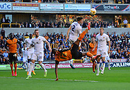 Benik Afobe attempts an overhead kick during the Sky Bet Championship match between Wolverhampton Wanderers and Leeds United at Molineux, Wolverhampton, England on 6 April 2015. Photo by Alan Franklin.