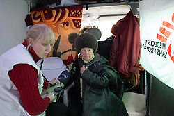 MSF nurse Ania Sharaya looks after a woman during a consultation in a the MSF mobile clinic van in a neighbourhood of Debaltsevo.