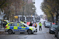 © Licensed to London News Pictures. 24/11/2019. London, UK. The scene where a man has been found stabbed to death outside a west London train station. The attack follows a stabbing in Whitechapel on Saturday, in which another man in his 20s was killed. Photo credit: Ben Cawthra/LNP