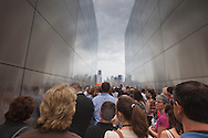 Visitors at the openning of  The Empty Sky Memorial 9/11 Memorial at Liberty State Park in New Jersey  by  the Architect  Frederic Schwartz  on September 10th 2011 for the tenth anniversary of 9/11.<br /> The memorial is two 30-Ft rectangular towers  208 feet by 10 inches long,  the width of the World Trade Center towers and with the names of the 746 New Jerseyans who perished after the terrorist attacks on 9/11, 2001  etched in stainless steel.