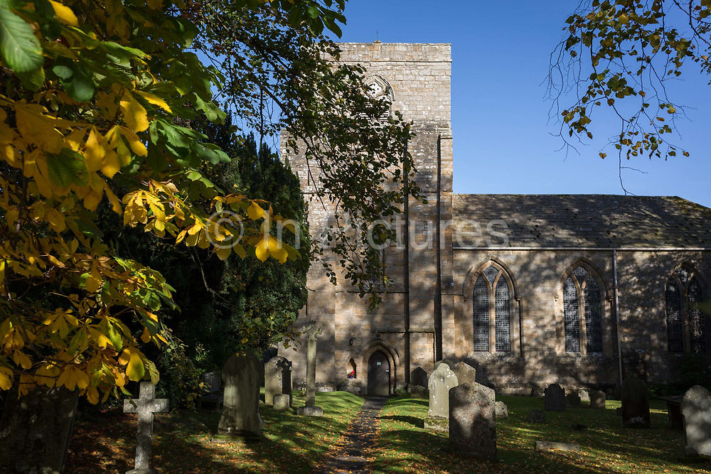 The church of St Marys in the Northumbrian village of Blanchland, on 29th September 2017, in Blanchland, Northumberland, England. St. Marys is on the site of the former Abbey and the village got its name from the white habits worn by monks of the Premonstratensian order who founded Blanchland Abbey. Built in the 13th century, the abbey survived until the 16th century when it fell into ruin. Parts of the Abbey survive including St. Marys Church, which was rebuilt in 1751-52. Blanchland is a village in Northumberland, England, on the County Durham boundary. It is a conservation village, largely built of stone from the remains of the 12th-century Abbey. It features picturesque houses, set against a backdrop of deep woods and open moors. Set beside the river in a wooded section of the Derwent valley, Blanchland is an attractive small village in the North Pennines Area of Outstanding Natural Beauty.