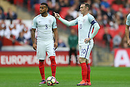 Wayne Rooney, the England captain makes his point with Ryan Bertrand of England looking on. FIFA World cup qualifying match, european group F, England v Malta at Wembley Stadium in London on Saturday 8th October 2016.<br /> pic by John Patrick Fletcher, Andrew Orchard sports photography.