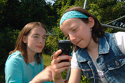 young girl shows friend her texts