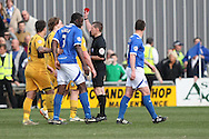 Adam Chapman of Newport is shown a red card. Skybet football league two match, Newport county v Portsmouth at Rodney Parade in Newport, South Wales on Saturday 29th March 2014.<br /> pic by Mark Hawkins, Andrew Orchard sports photography.