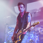 SIMON GALLUP of The Cure performs at Merriweather Post Pavilion.  The band performed 32 songs in a career-spanning set.