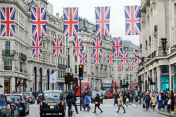 © Licensed to London News Pictures. 27/04/2018. LONDON, UK.  Union flags decorate Regent Street ahead of the upcoming Royal wedding of Prince Harry and Meghan Markle.  Photo credit: Stephen Chung/LNP