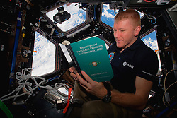 EARTH Aboard the International Space Station -- 28 Feb 2016 -- British ESA astronaut Tim Peake reads a copy of Isaac Newton's Philosophiae Naturalis Pricipia Mathematica (in Latin) during some rare time off aboard the International Space Station as his Principia mission continues. EXPA Pictures © 2016, PhotoCredit: EXPA/ Photoshot/ Atlas Photo Archive/NASA<br /><br />*****ATTENTION - for AUT, SLO, CRO, SRB, BIH, MAZ, SUI only*****