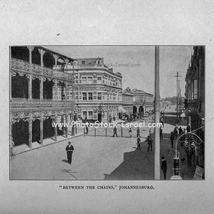 Between the Chains Johannesburg [This is the financial heart of the Witwatersrand, and, it may be said, of South Africa. A portion of Simmonds Street, between Commissioner and Pritchard Streets, has been railed off to prevent vehicular traffic passing through] from the book ' Boer and Britisher in South Africa; a history of the Boer-British war and the wars for United South Africa, together with biographies of the great men who made the history of South Africa ' By Neville, John Ormond Published by Thompson & Thomas, Chicago, USA in 1900