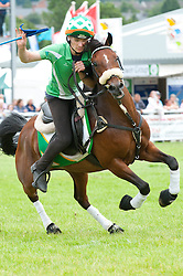 © Licensed to London News Pictures. 21/07/2015. Llanelwedd, UK. An Irish team rider negotiates the course. Teams of riders take part in theRoyal Welsh Mounted Games – International World Team Championships. The Royal Welsh Show is hailed as the largest & most prestigious event of it's kind in Europe. In excess of 200,000 visitors are expected this week over the four day show period - 2014 saw 237,694 visitors, 1,033 tradestands & a record 7,959 livestock exhibitors. The first ever show was at Aberystwyth in 1904 and attracted 442 livestock entries. Photo credit: Graham M. Lawrence/LNP