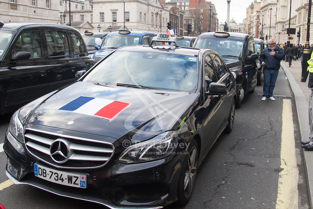 Whitehall, London, February 10th 2016. A Paris taxi driver joins his London counterparts in solidarity as an estimated 8,000 cabbies hold a go-slow in protest against what they say is unfair competition from minicab and Uber drivers who do not have to undergo the rigorous training and checks required for the licenced taxi trade. ///FOR LICENCING CONTACT: paul@pauldaveycreative.co.uk TEL:+44 (0) 7966 016 296 or +44 (0) 20 8969 6875. ©2015 Paul R Davey. All rights reserved.