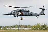 New Windsor, New York - A New York Air National Guard 106th Rescue Wing HH-60(G) Pavehawk helicopter crew performs a search and rescue demonstration on the first day of the New York Air Show at Stewart International Airport on Aug. 29, 2015.