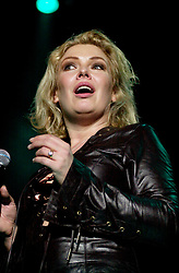 Kim Wilde steps out of the her TV Gardening clothes and Back on Stage to Tour with<br /><br />Steve Starnge (Visage)<br />Claire Grogan (Altered Images)<br />The Belle Stars<br />Dollar<br />Kim Wilde<br />The Human League<br />Play on the Here and Now  Christmas Party Tour at Sheffields Hallam FM Arena Friday 13th December 2002<br /><br />[#Beginning of Shooting Data Section]<br />Nikon D1 <br />2002/12/13 22:48:53.5<br />JPEG (8-bit) Fine<br />Image Size:  2000 x 1312<br />Color<br />Lens: 80-200mm f/2.8-2.8<br />Focal Length: 80mm<br />Exposure Mode: Manual<br />Metering Mode: Spot<br />1/200 sec - f/2.8<br />Exposure Comp.: 0 EV<br />Sensitivity: ISO 800<br />White Balance: Auto<br />AF Mode: AF-S<br />Tone Comp: Normal<br />Flash Sync Mode: Not Attached<br />Color Mode: <br />Hue Adjustment: <br />Sharpening: Normal<br />Noise Reduction: <br />Image Comment: <br />[#End of Shooting Data Section]