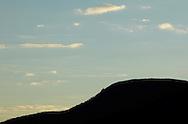 Mountainville, New York - The setting sun illuminates clouds behind Schunnemunk Mountain on Nov. 28, 2010.