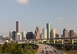 Houston, Texas skyline viewed from the north with freeway in foreground.