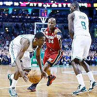 18 March 2013: Boston Celtics shooting guard Jordan Crawford (27) drives past Miami Heat shooting guard Ray Allen (34) on a screen set by Boston Celtics power forward Jeff Green (8) during the Miami Heat 105-103 victory over the Boston Celtics at the TD Garden, Boston, Massachusetts, USA.