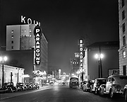 deLay481122-1 Night view of SW Broadway looking north from Madison. Paramount & Broadway theaters. November 22, 1948.