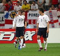 Photo: Chris Ratcliffe.<br /> England v Portugal. Quarter Finals, FIFA World Cup 2006. 01/07/2006.<br /> David Beckham of England and Gary Neville.