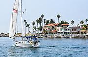 Sailing Past Balboa Peninsula Mansions