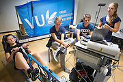 Sanne is bezig met de inspanningstest. Aan de VU Amsterdam worden potentiele rijders voor de VeloX5 getest. In september wil het Human Power Team Delft en Amsterdam, dat bestaat uit studenten van de TU Delft en de VU Amsterdam, een poging doen het wereldrecord snelfietsen te verbreken, dat nu op 133,8 km/h staat tijdens de World Human Powered Speed Challenge.<br /> <br /> At the VU Amsterdam possible riders for the VeloX5 are tested. With the special recumbent bike the Human Power Team Delft and Amsterdam, consisting of students of the TU Delft and the VU Amsterdam, also wants to set a new world record cycling in September at the World Human Powered Speed Challenge. The current speed record is 133,8 km/h.