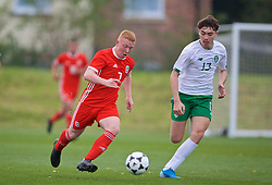 WREXHAM, WALES - Wednesday, October 30, 2019: Wales' Aaron Bennett (L) and Republic of Ireland's Conor Barrett during the 2019 Victory Shield match between Wales and Republic of Ireland at Colliers Park. (Pic by David Rawcliffe/Propaganda)