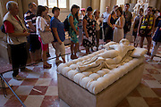 Tourists admire the marble statue of Hermaphrodite at the Louvre, Paris. Hermaphroditus is  life size, reclining on a couch with a form that is partly derived from ancient portrayals of Venus and other female nudes and partly from contemporaneous feminised Hellenistic portrayals of Dionysus/Bacchus. It represents a subject that was much repeated in Hellenistic times and in ancient Rome, to judge from the number of versions that have chanced to survive. It derives its name from its best known examples, in marble, which were part of the Borghese collection..