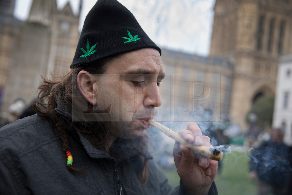 © Licensed to London News Pictures. 23/02/2018. London, UK. Campaigner Mars Bilters smokes a pipe near Parliament during a demonstration in support of cannabis for medicinal use - as MPs debate it's use in The House of Commons. Photo credit: Peter Macdiarmid/LNP