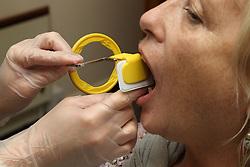 Woman at dentist having x-ray