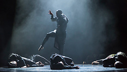 """© Licensed to London News Pictures. 17/10/2019. LONDON, UK.  Dancers from the Vuyani Dance Theatre and a South African a cappella quartet perform at a preview of """"Cion - A Requiem to Ravel's Bolero"""" by Gregory Maqoma.  The show runs 17 to 19 October 2019 at the Barbican Theatre and is part of this year's Dance Umbrella festival.  Photo credit: Stephen Chung/LNP"""