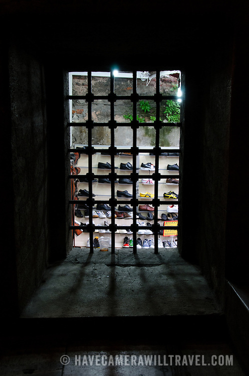 A shoe market stall seen through the metal grill of the stairway at Istanbul's Rustem Pasha Mosque near the Spice (Egyption) Market.