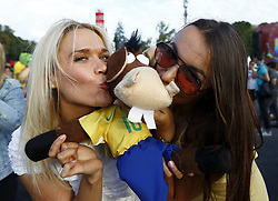 July 2, 2018 - Moscow, Russia - Supporters at Fan Zone - FIFA World Cup Russia 2018.Two russian girls kissing the Brazil mascotte at Fifa Fan Zone in Moscow, Russia on July 2, 2018. (Credit Image: © Matteo Ciambelli/NurPhoto via ZUMA Press)