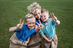 Three young blond boys posing in Sackrace