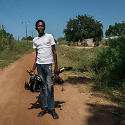 Sandema / Maxwell Awankanaab (15), student:<br /> <br /> Today is market day so I am rushing to the market to go and sell the chicken and ducks. Each one is 25 cedis. I am selling them for my brother. I need to get some money so I can buy a new school uniform. I am in class 6. I want to be a soldier in future.