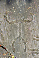 Petroglyph, rock carving, of a human figure. Carved by the ancient Camunni people in the copper age between 3200-2200 BC. Rock no 29, Foppi di Nadro, Riserva Naturale Incisioni Rupestri di Ceto, Cimbergo e Paspardo, Capo di Ponti, Valcamonica (Val Camonica), Lombardy plain, Italy .<br /> <br /> Visit our PREHISTORY PHOTO COLLECTIONS for more   photos  to download or buy as prints https://funkystock.photoshelter.com/gallery-collection/Prehistoric-Neolithic-Sites-Art-Artefacts-Pictures-Photos/C0000tfxw63zrUT4<br /> If you prefer to buy from our ALAMY PHOTO LIBRARY  Collection visit : https://www.alamy.com/portfolio/paul-williams-funkystock/valcamonica-rock-art.html