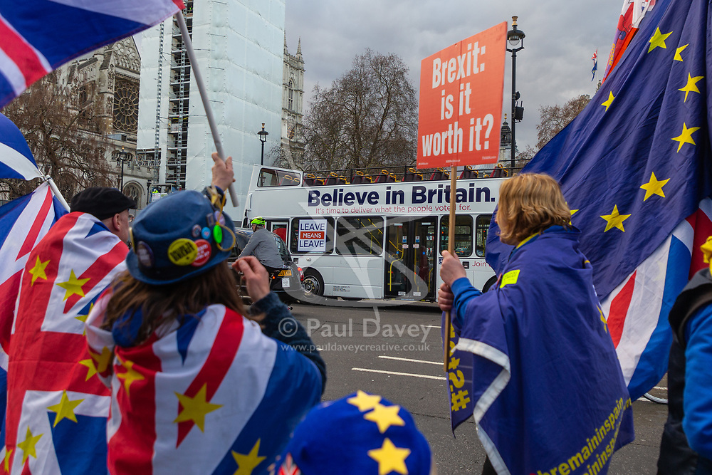 Pro-EU demonstrators outside the Houses of Parliament jeer as a bus emblazoned with Leave Means Leave campaign slogans passes Parliament Square. London, January 14 2019.