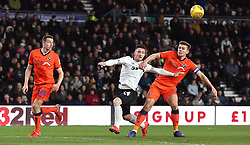 Derby County's Jack Marriott and Millwall's Shaun Hutchinson (right) battle for the ball during the Sky Bet Championship match at Pride Park, Derby.