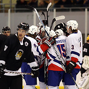 Sigurdur Reynisson, Iceland, is congratulated by team mates after scoring during the Iceland V New Zealand match during the 2012 IIHF Ice Hockey World Championships Division 3 held at Dunedin Ice Stadium. Dunedin, Otago, New Zealand. 19th January 2012. Photo Tim Clayton