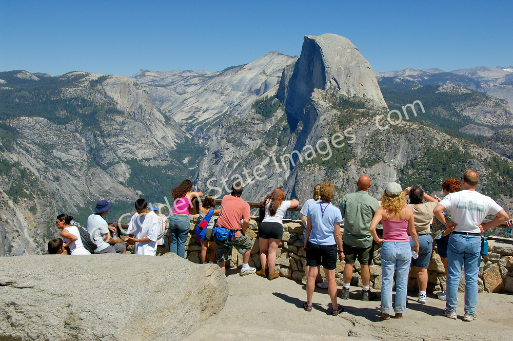 Park visitors view Half Dome from Glacier Point.