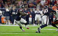 Houston Texans running back Alfred Blue (28) rushes for a touchdown against the Cincinnati Bengals during the second half of an NFL football game Saturday, Dec. 24, 2016, in Houston. (AP Photo/Sam Craft)